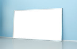 White blank canvas 3D rendering. White blank canvas on blue wall 3D rendering Stock Photo