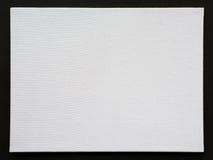 White blank canvas frame on black cardboard Stock Photo