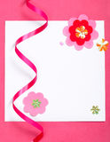 White blank card on pink paper Royalty Free Stock Images