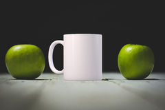White blank coffee mug ready for your custom design/quote. Stock Photos