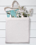 White blank cotton eco tote bag, design mockup. White blank cotton eco tote bag with flowers and notebook, design mockup Stock Images