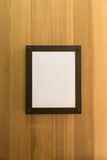 White blank empty brown photo Frame on wooden wall. Background, Wallpaper. royalty free stock photos
