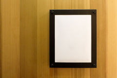White blank empty brown photo Frame on wooden wall. Background, Wallpaper. White blank empty brown photo Frame on wooden wall. Background, Wallpaper Stock Photo