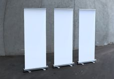 White blank empty high resolution Business Roll Up and  Standee Banner display mock up Template for your Design Presentation. Royalty Free Stock Photos