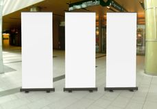 White blank empty high resolution Business Roll Up and  Standee Banner display mock up Template for your Design Presentation. Stock Photography
