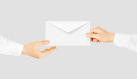 White blank envelope giving hand. Message send presentation. Royalty Free Stock Photo