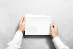 White blank envelope mock up holding in hand Royalty Free Stock Photos