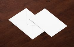 White blank envelope mockup and blank letterhead presentation template. White envelope and post card on a background, top view. Blank envelope mockup and blank Royalty Free Stock Photography
