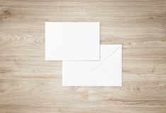 White blank envelope mockup and blank letterhead presentation template. White envelope and post card on a background, top view. Blank envelope mockup and blank Royalty Free Stock Photo