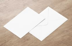White blank envelope mockup and blank letterhead presentation template. White envelope and post card on a background, top view. Blank envelope mockup and blank Royalty Free Stock Image