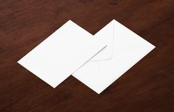 White blank envelope mockup and blank letterhead presentation template. White envelope and post card on a background, top view. Blank envelope mockup and blank Royalty Free Stock Images