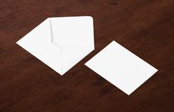 White blank envelope mockup and blank letterhead presentation template. White envelope and post card on a background, top view. Blank envelope mockup and blank Stock Image