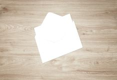 White blank envelope mockup and blank letterhead presentation template. White envelope and post card on a background, top view. Blank envelope mockup and blank Stock Photos