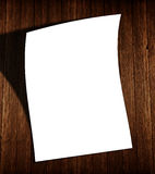 White blank flyer on wood with shadow royalty free stock photography
