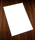 White blank flyer on wood. Blank white A4 size flyer placed on wood,  flyer on wood Stock Photography