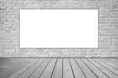 White blank on gray brick wall and wooden floor. royalty free stock image