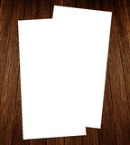 White blank 4x8 inches flyer on wood. Blank White 4x8 inches size flyer on wood Stock Photo