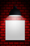 White blank and lamp hanging on red wall. With place for text Stock Photography