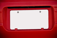 White Blank License Plate On Red Car Stock Image