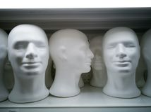 A White Blank White Male Head. A Group of New Blank White Male Head on Shop Rack Stock Image