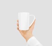 White blank mug mock up holding hand isolated. Stock Images