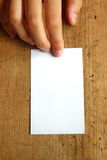 White blank name card. On wood background Stock Photography
