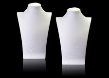 White blank necklace mannequin stands Isolated on black backgrou Stock Photo
