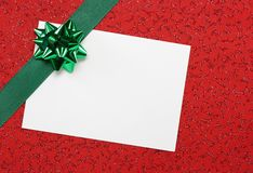 White blank note with green ribbon Stock Photos
