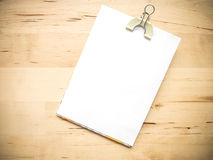 White blank note paper and cliped on wood Royalty Free Stock Photo