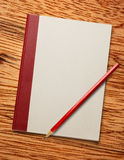 White blank notebook with red pencil Stock Photo