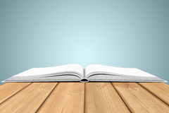 White blank open book on wooden planks Stock Photos