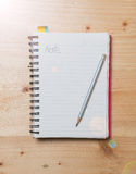 White blank pages note book on wood table royalty free stock photography