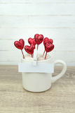 White blank paper clipped on coffee cup with glitter red heart Stock Photo