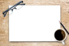 White blank paper or notepad on wood table Stock Images