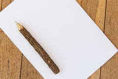 White blank paper sheet with wooden pen on table Royalty Free Stock Image