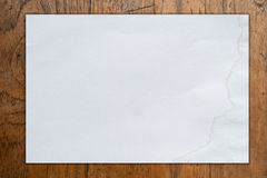 White blank paper on  wood background Stock Photography