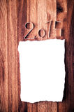 White blank paper for 2015 year on oak wooden background. Stock Image