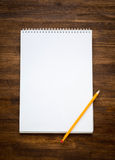 White blank papers in a copybook with pen on the Stock Photo