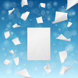White blank papers flying away - new year resolutions idea. White blank papers flying away into the winter snowflakes  - new year resolutions idea Royalty Free Stock Photos