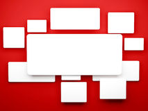 White blank pictures on the red wall. Stock Image