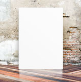White Blank Poster in crack cement wall and diagonal wooden floo Stock Images