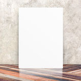 White Blank Poster in crack cement wall and diagonal wooden floo Royalty Free Stock Photography