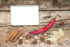 White Blank Recipe Notepad with Spices on wood background Stock Photos