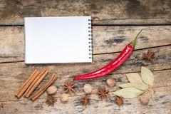 White Blank Recipe Notepad with Spices on wood background Royalty Free Stock Image