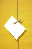 White blank reminder note on yellow background Royalty Free Stock Photo