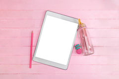 White blank screen tablet with clipping path on pink wood backgr. Ound, easy to insert image , wording or other graphic on screen Stock Photo