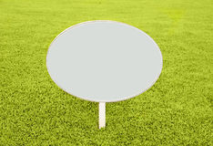 white blank sign on grass Stock Photos