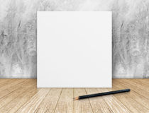 White Blank square Poster in concrete wall and wooden floor room Royalty Free Stock Photos