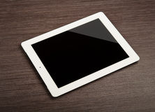 White blank tablet   on a desk Royalty Free Stock Image