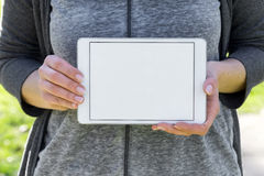White blank tablet held by woman Stock Photography